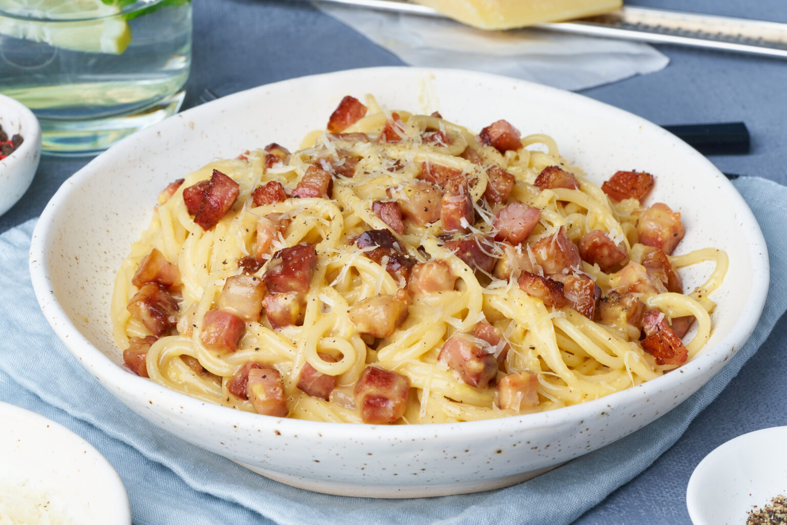 Carbonara pasta. Spaghetti with pancetta, egg, parmesan cheese and cream sauce. Traditional italian cuisine. Side view.