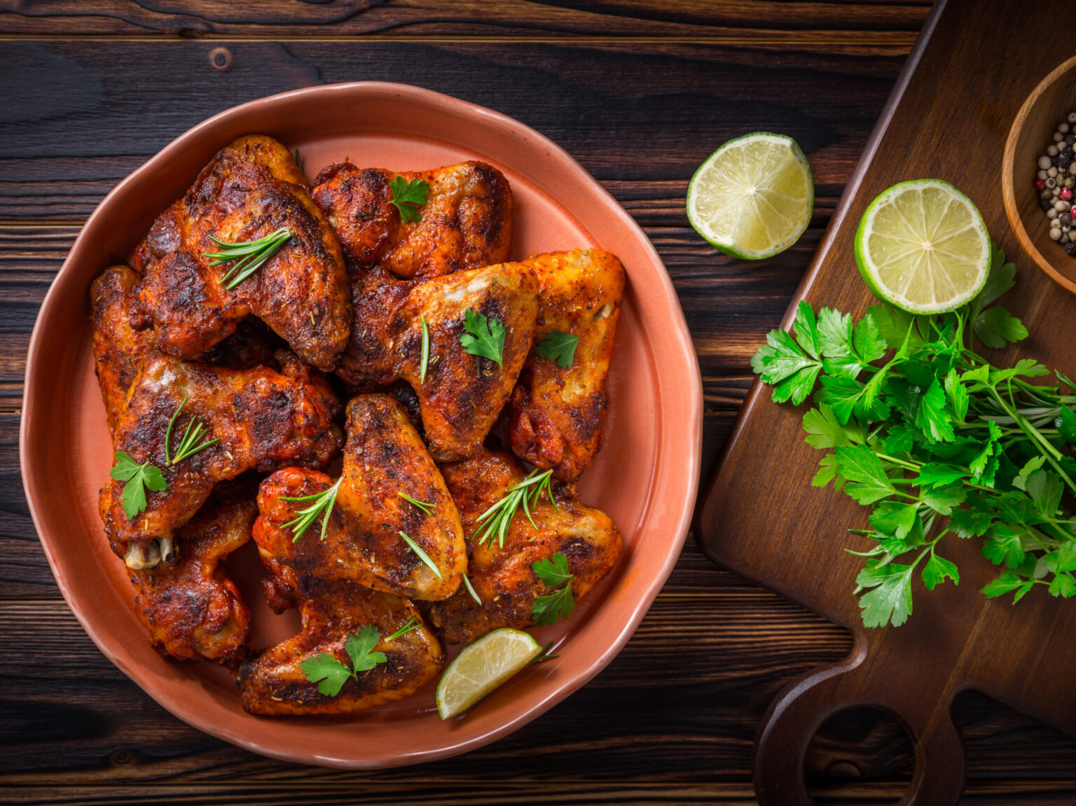 Hot and Spicey Buffalo Chicken Wings with ingredients on wooden background
