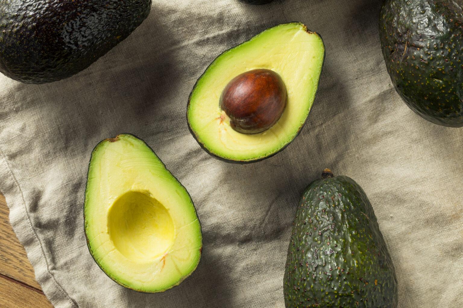 Raw Organic Green Avocados Ready to Cut Open