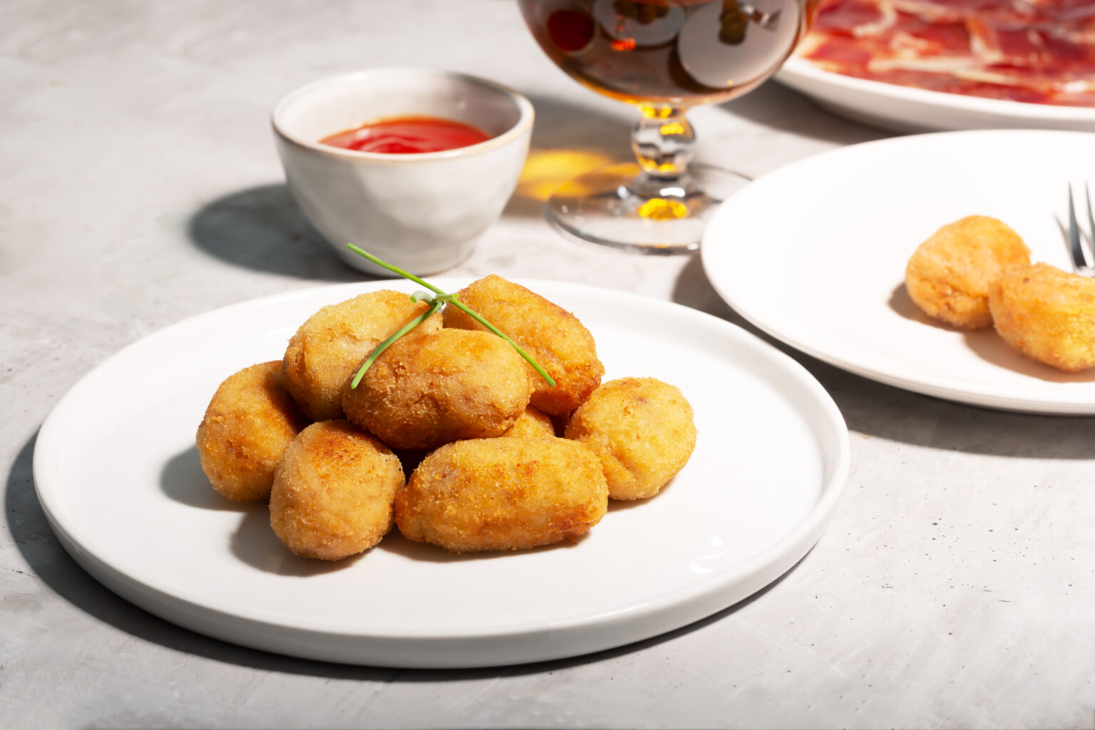 Tapas croquettes, traditional Spanish snack usually prepared with mashed potatoes, meat or vegetables