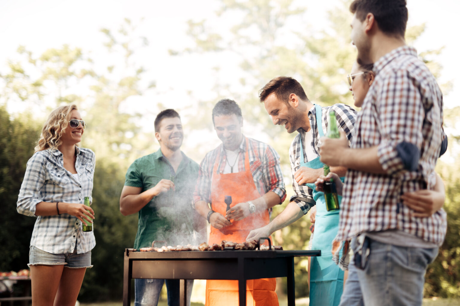 Friends camping and having a barbecue in nature