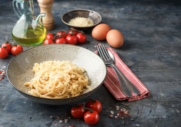 Pasta Linguine with scrambled eggs and parmesan cheese. Traditional italian cuisine.